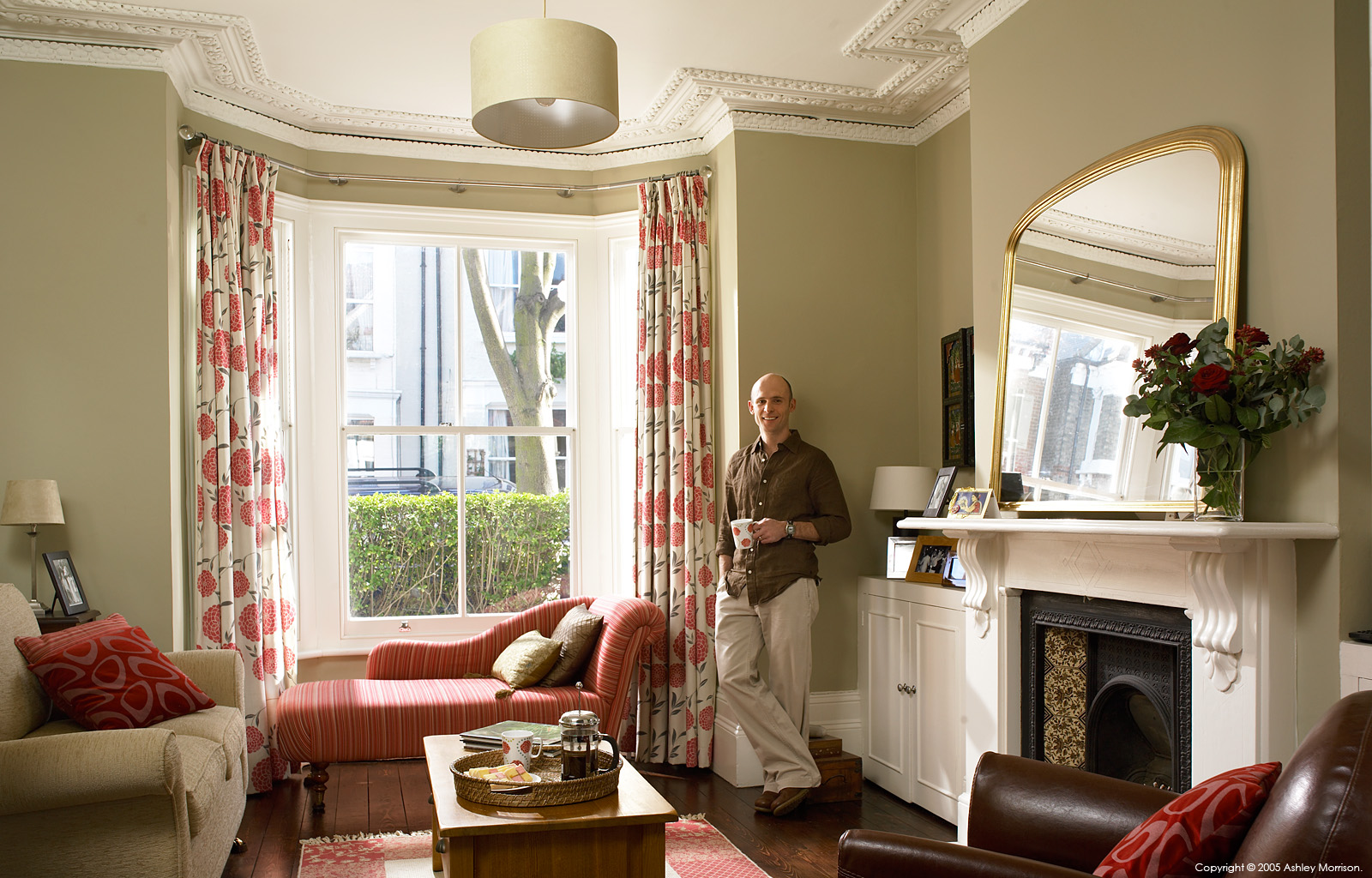 TV presenter Ian Blandford in the sitting room of his Victorian terraced house in the Clapham area of London.