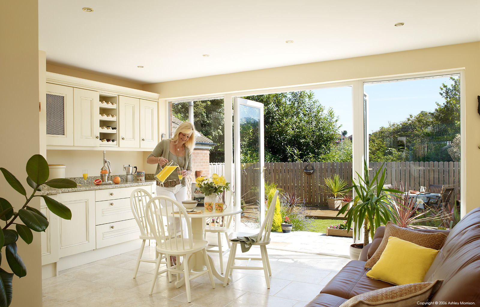 Shakila Cowan in the kitchen extension of her transformed 1950s semi detached house in Belfast.