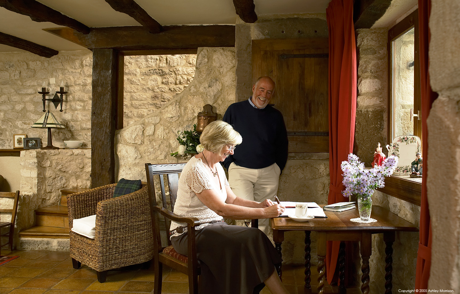 Angela and John Goodwin in their 15th century Manoir or Tower house near the medieval hill village of Cordes sur ciel in the French Tarn region.