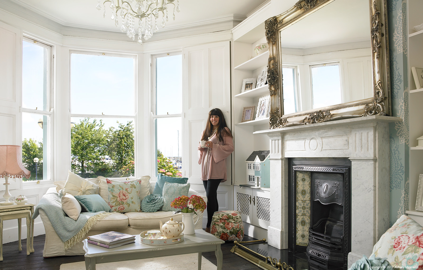 Amanda McGuile in the front room of her mid terrace family home overlooking Bangor Marina in County Down by Ashley Morrison.