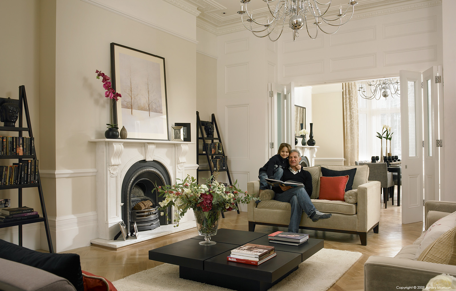Kaveh Mobasheri & his son in the sitting room of their semi-detached house in the Camden area of London by Ashley Morrison.