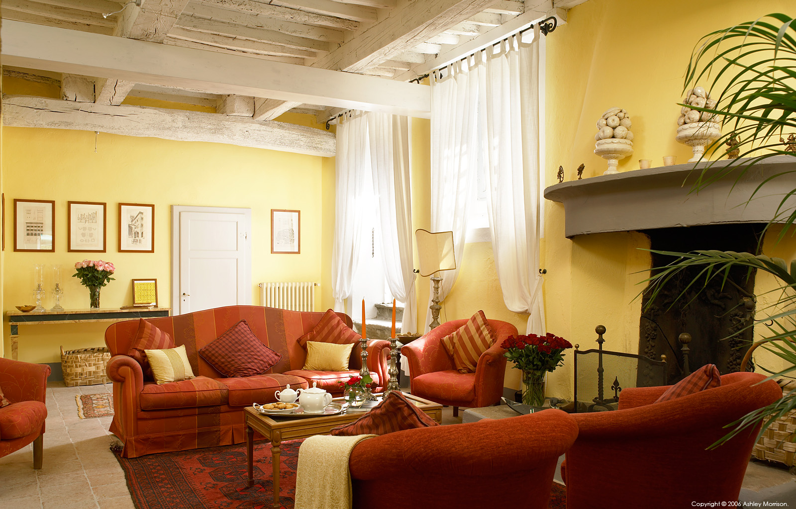 The sitting room in Dizzi Alfons' 18th-century former farmhouse which is set in a rural estate near the medieval town of Lucca in the northern Tuscany region of Italy.
