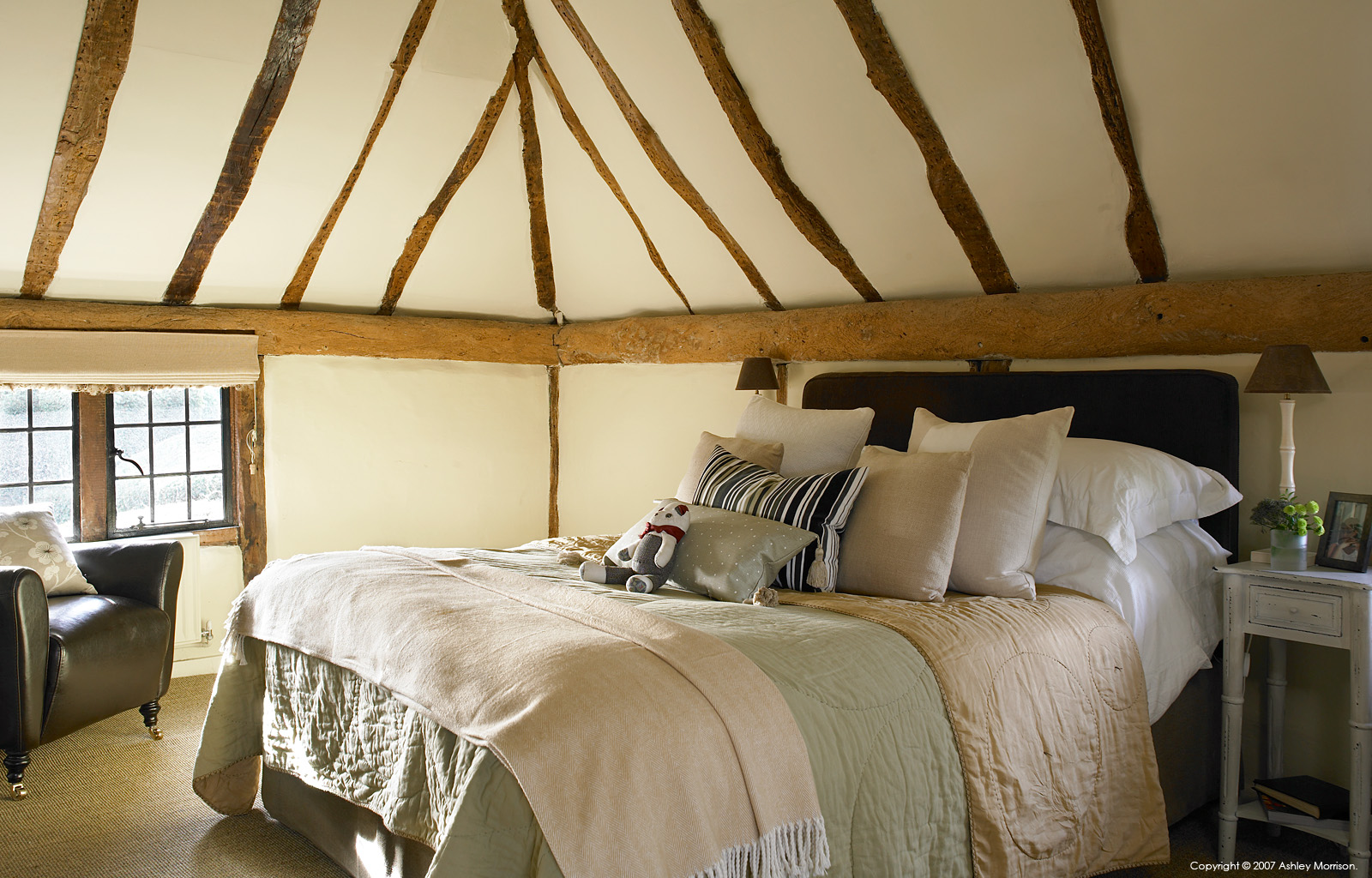The master bedroom in Beth and Jason Cooper's 16th-century Barn style house near Guildford in Surrey.