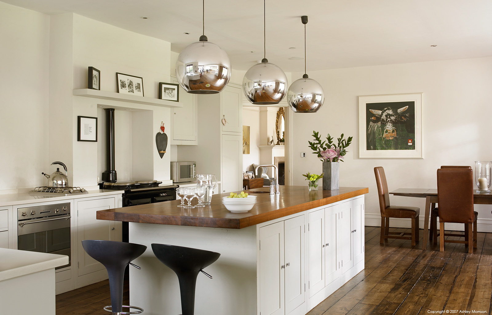 A Plain English kitchen in Coral and Rob Garlick's Edwardian mansion located near Godalming in Surrey.