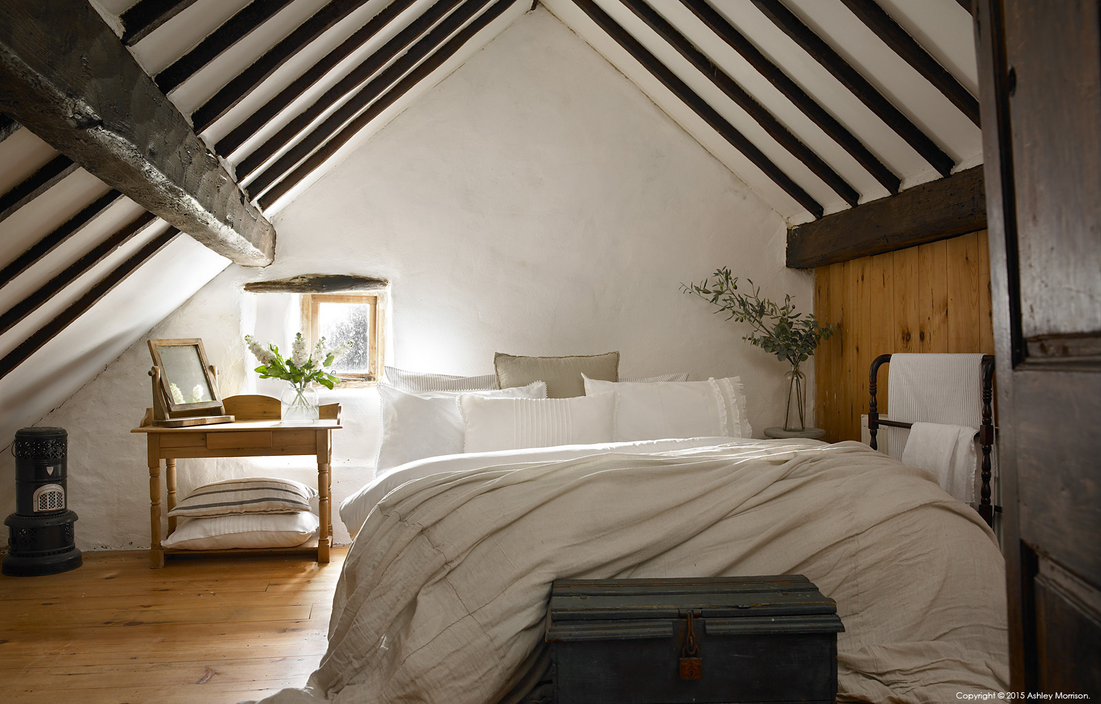 The master bedroom in Maggie and Robert Graham's 18th century Irish thatched cottage near the village of Kerrykeel in County Donegal.