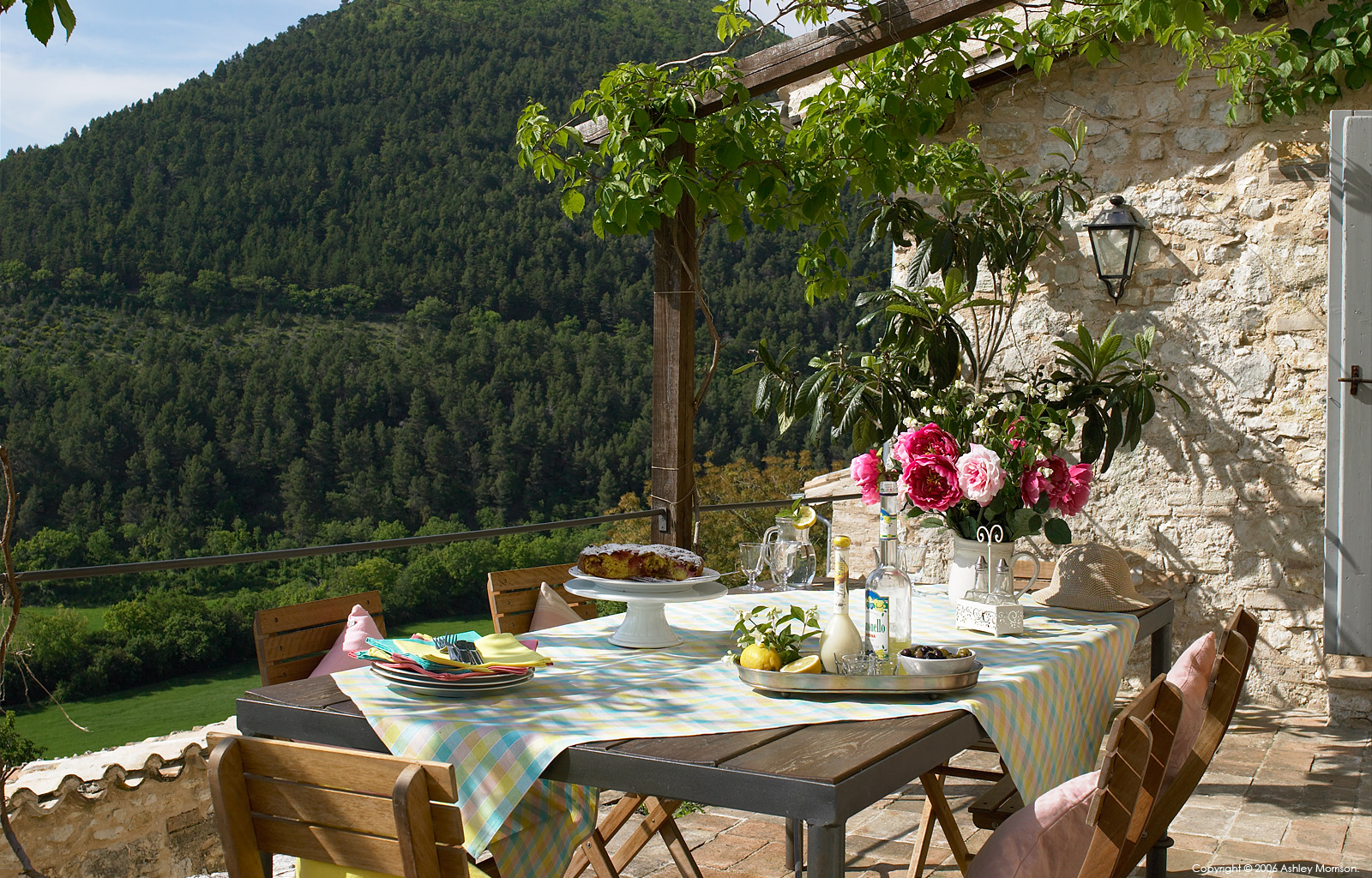 Outdoor dining at Casa della Roccia in the stone hamlet called Borgo Pianciano near Spoleto.