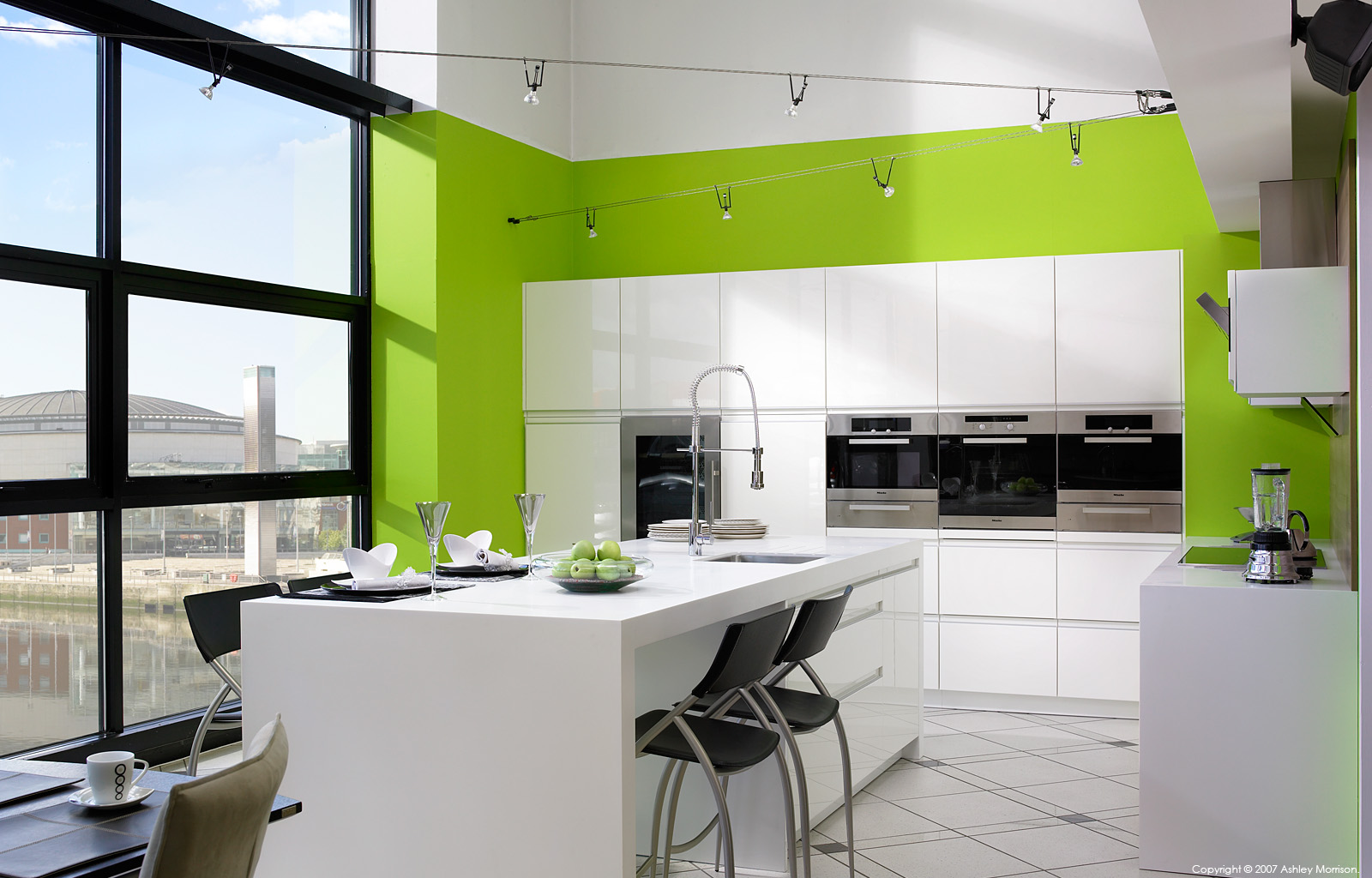 A Robinson Interiors High Gloss white kitchen overlooking Belfast Laganside by Ashley Morrison.