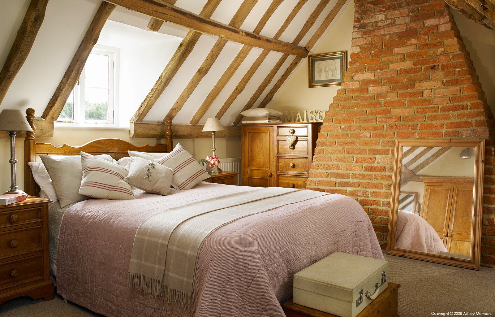 Bedroom in the attic of Tracey & Andy Rosser's cottage near Checkendon in Oxfordshire by Ashley Morrison.