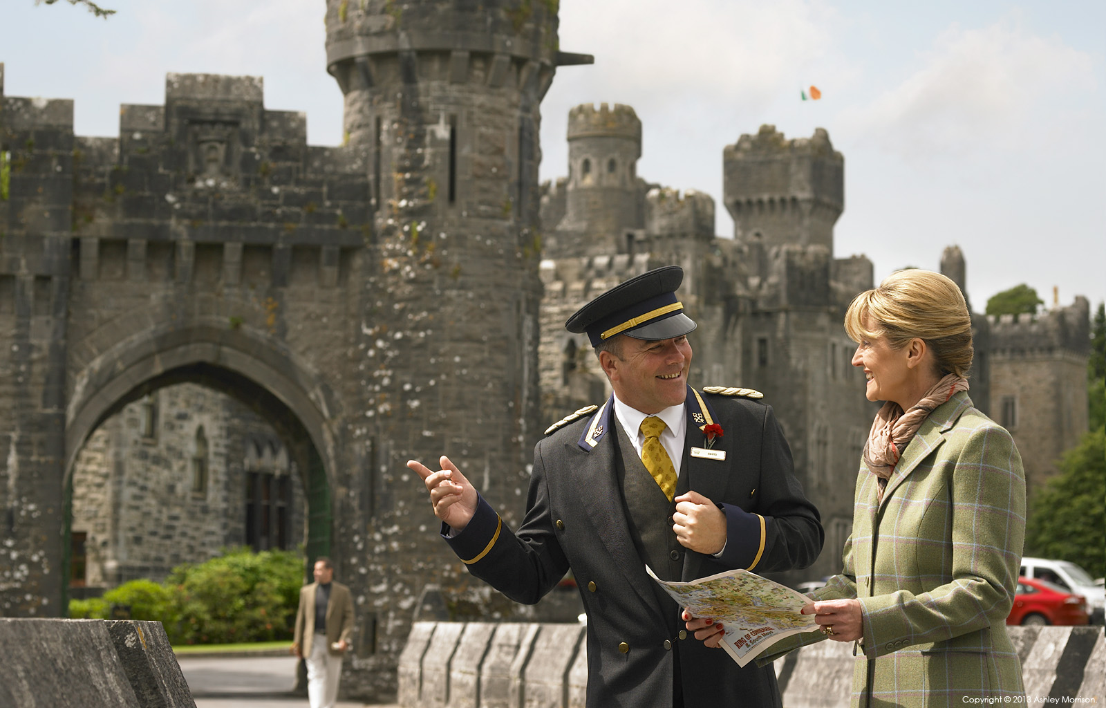The Doorman at Ashford Castle in County Mayo talking to a guest on the bridge by Ashley Morrison.