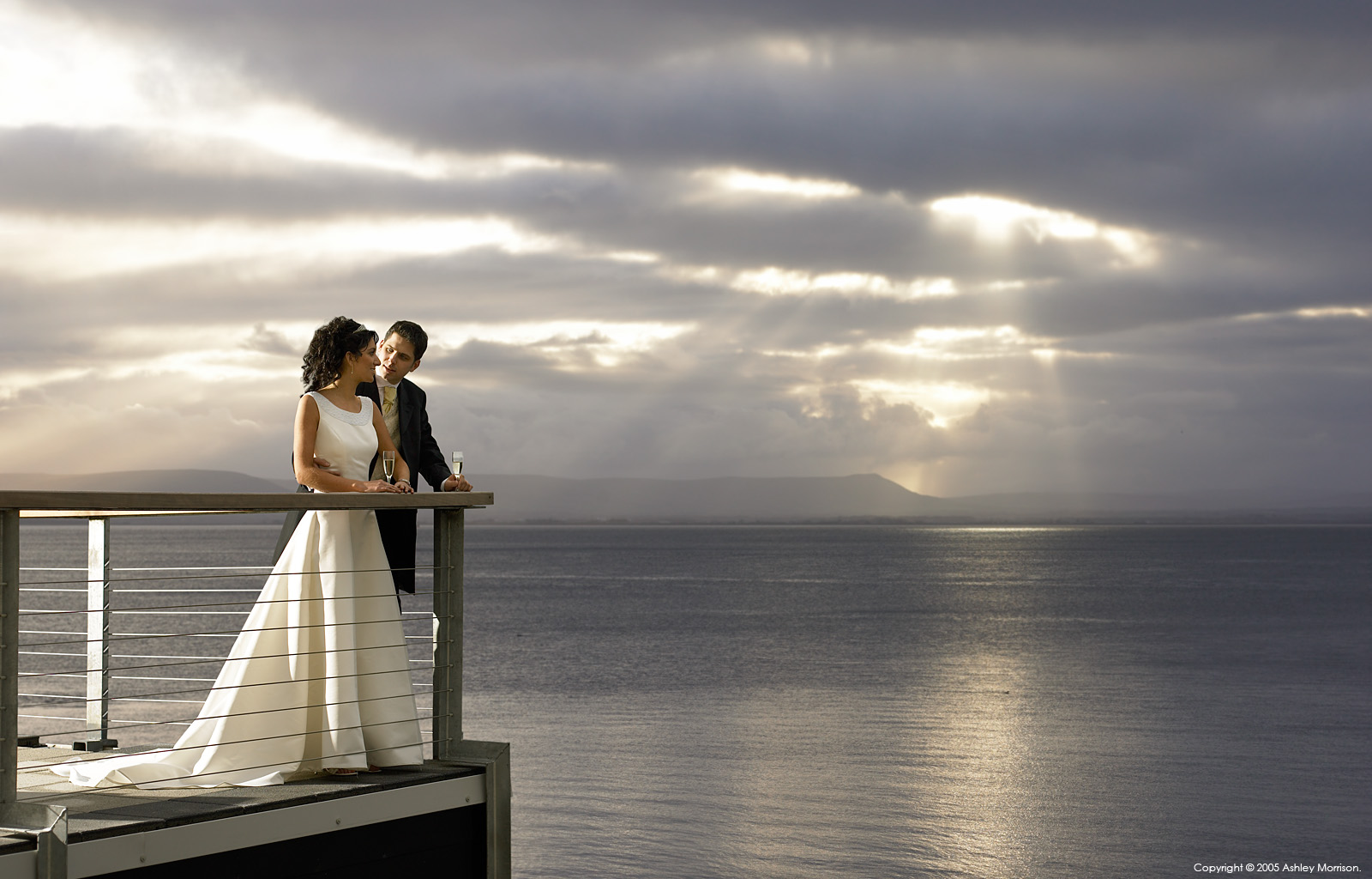 Bride and Groom out on the balcony at the Redcastle Hotel near the town of Moville on the Inishowen Peninsula of County Donegal.